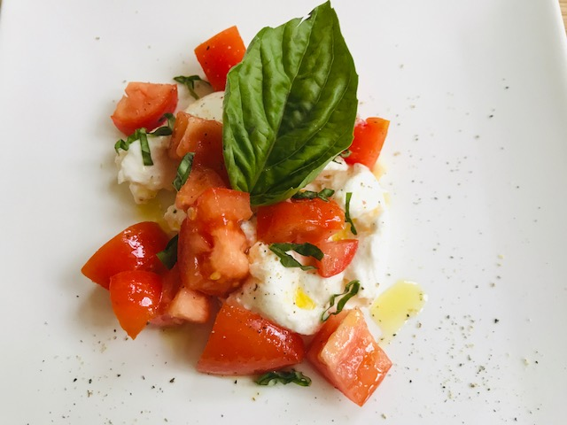luscious Burrata cheese with tomatoes or roasted peppers