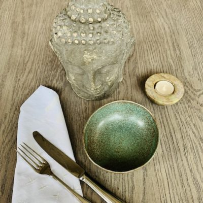 buddha head with bowl and candle