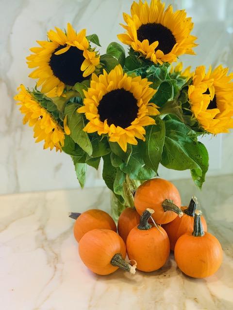 Pumpkins and sunflowers