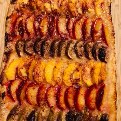 fruit tart with plums, figs, peaches
