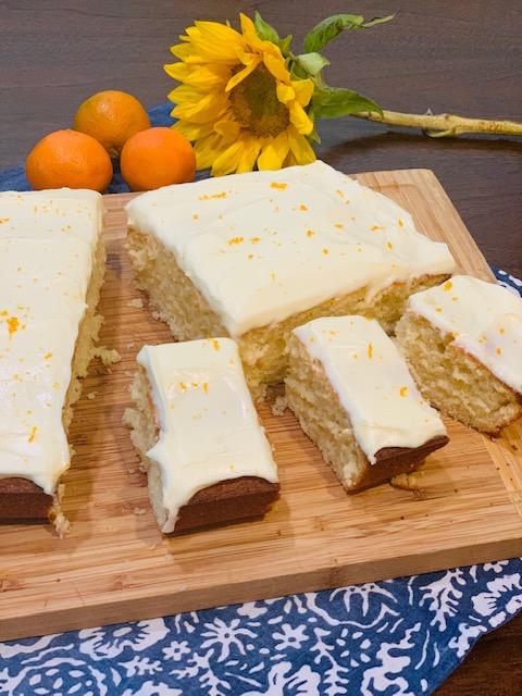 Vanilla sheet cake with orange cream cheese frosting