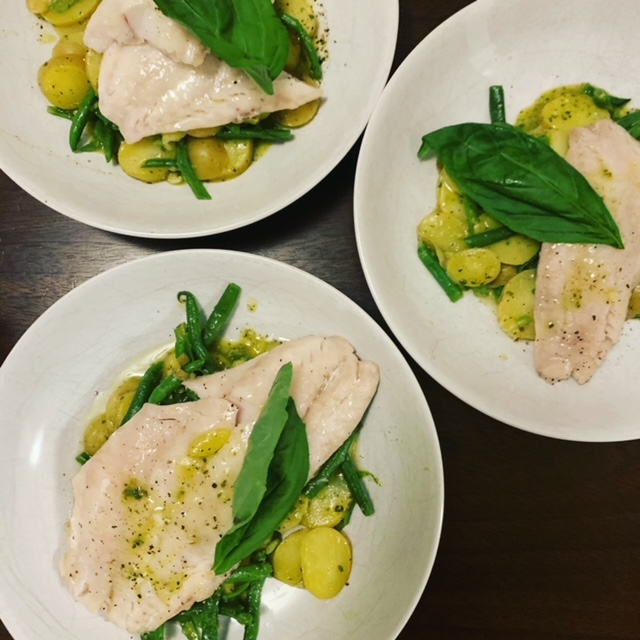 Fish fillets with green beans & potatoes in pesto broth