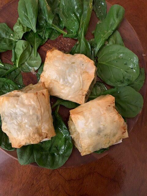 Chicken, spinach & herbs in phyllo bundles